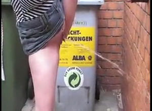 Steamy woman urinating on public place