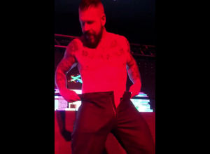Bearded homo dancing Striptease at..