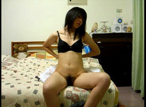 Teenage Asian woman strips in front of..