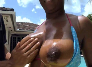 Chesty ebony neighbor sitting on a..
