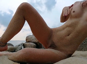 Fabulous damsel naturist at the beach